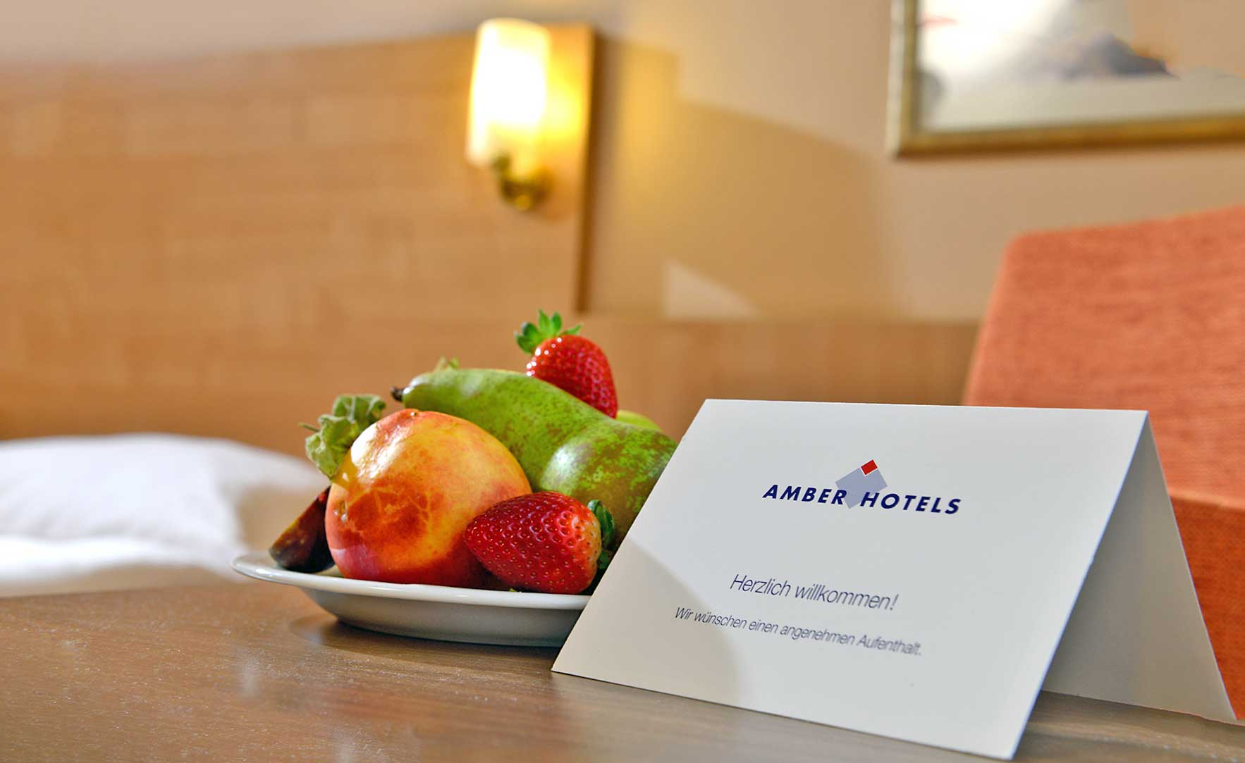 Zimmerbild mit Obstkorb und Willkommens Gruß